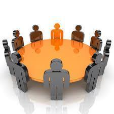 Graphic of several people figures sitting around a meeting table.
