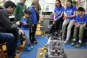 Members of the Westfield High School robotics team help McKinley students during a robotics session, part of the 6th annual STEAM Night at McKinley on Jan. 24.