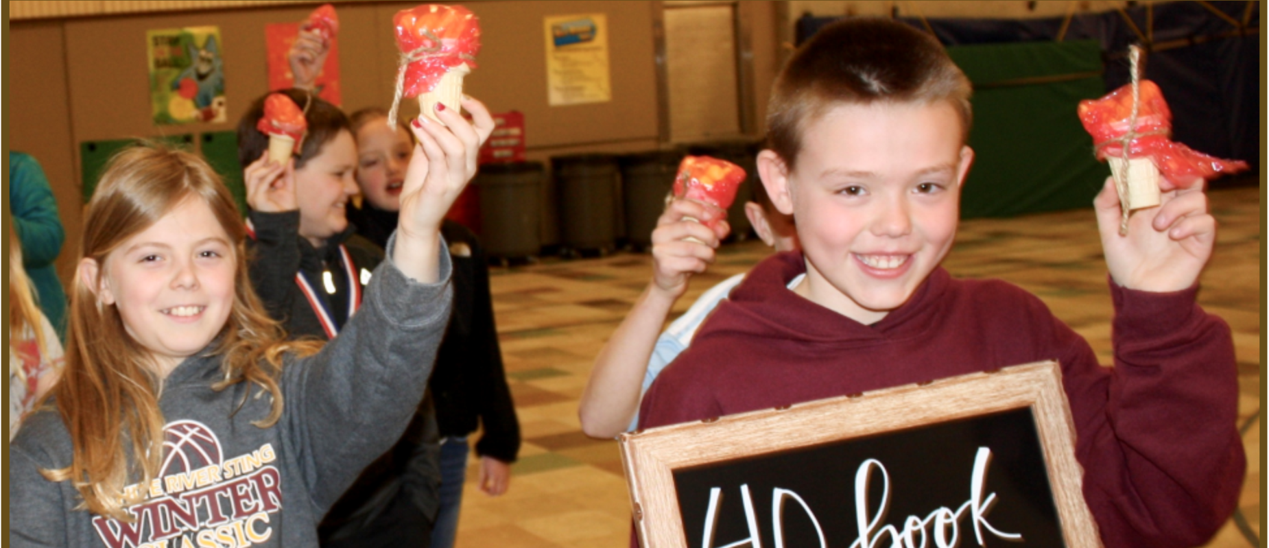 students joining in a fun march holding icecream cone flames