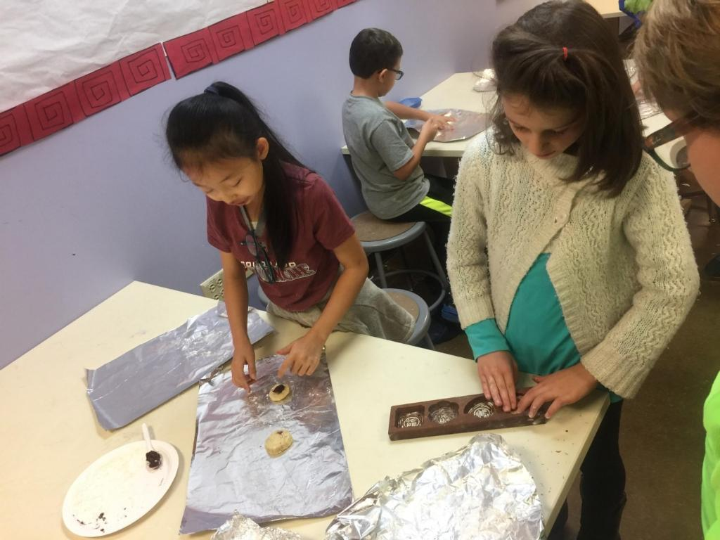 Middle Schoolers have fun at the moon cake party.