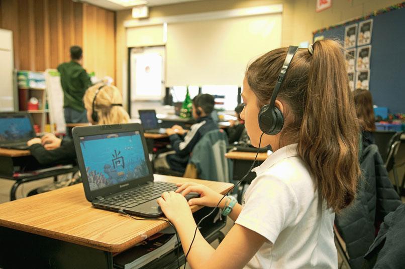 HudsonWay Immersion School student on her Chromebook
