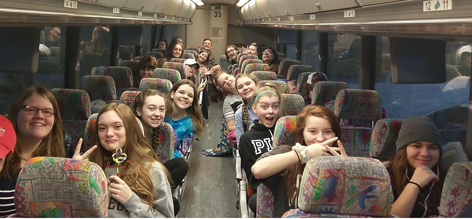Chorus group on a bus headed to Boston