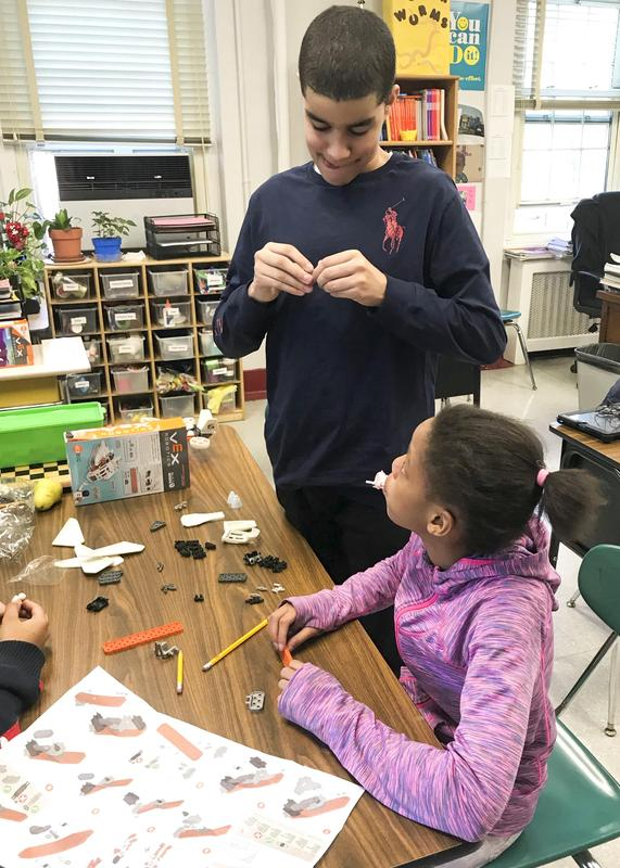 2 Van Cleve students working on their projects