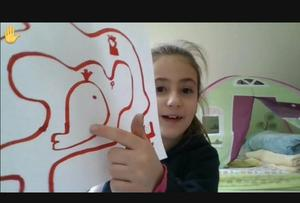 Girl showing her drawing
