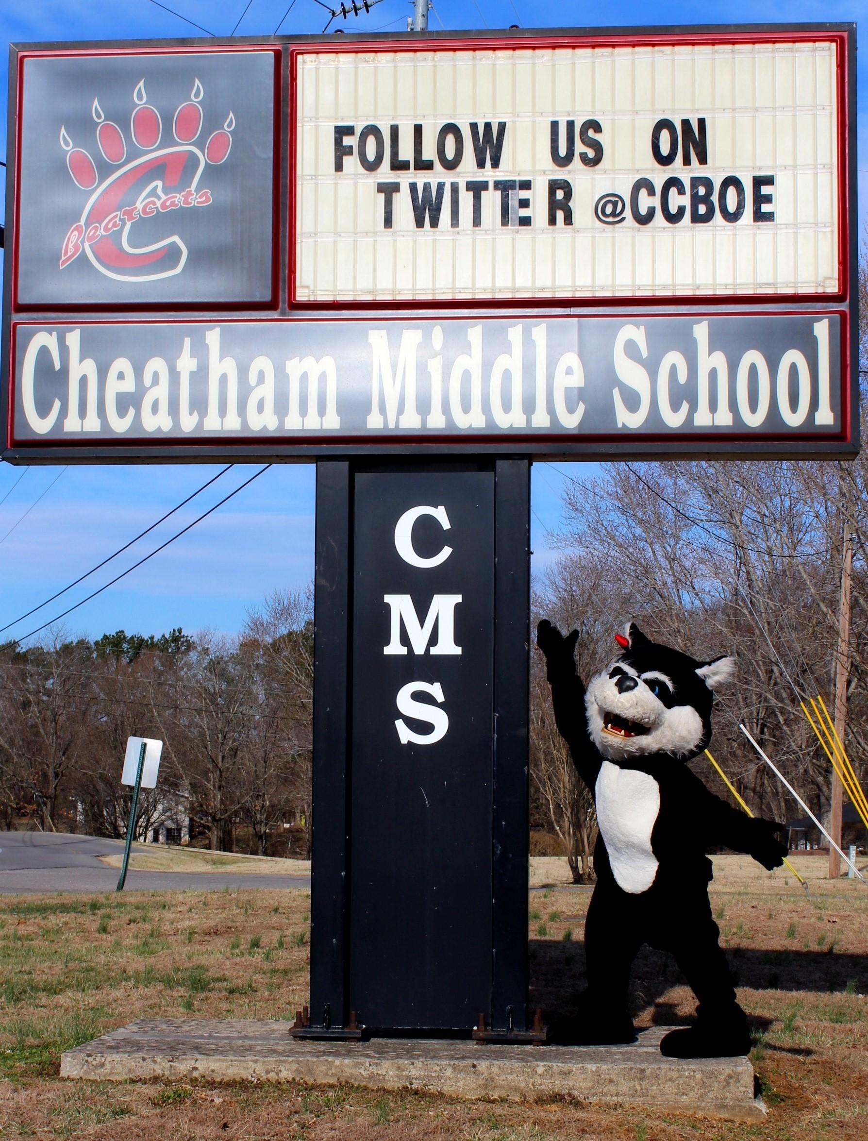 Mascot bearcat at school sign