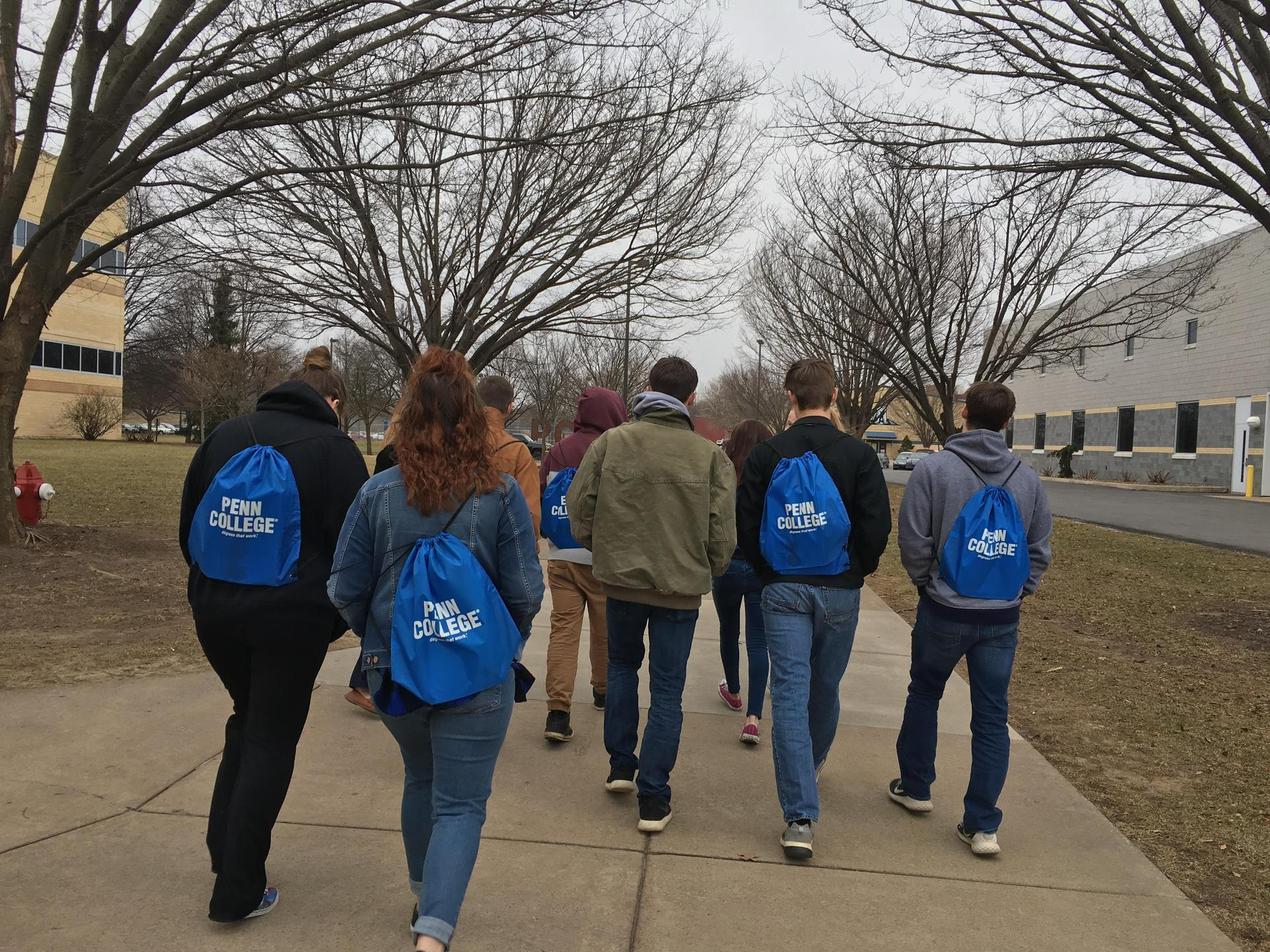students on a walking tour of a college