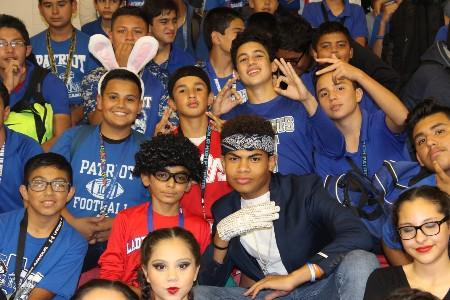 8th grade students pose for a photo during our Fall pep rally.
