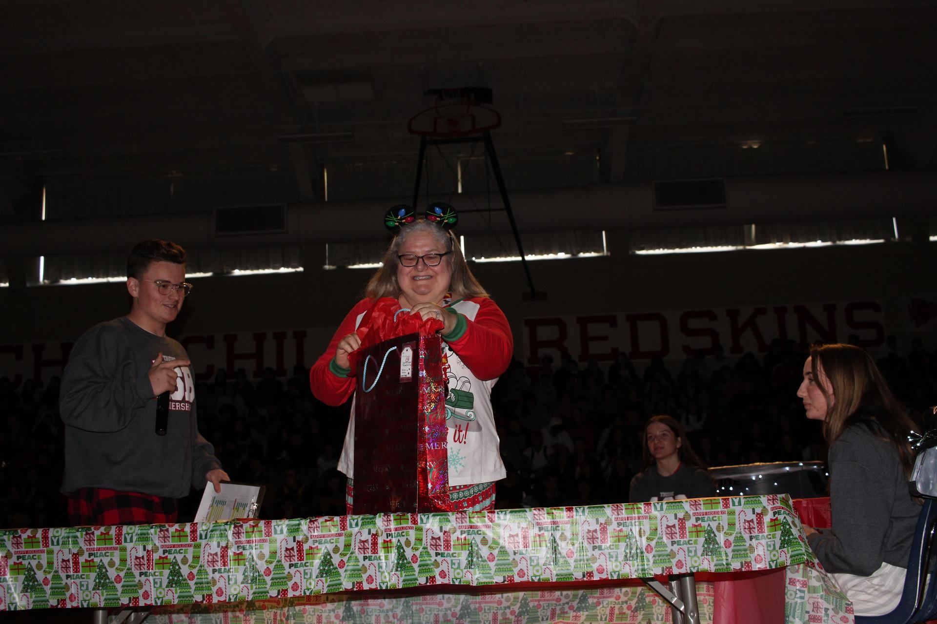 Mrs. Freitas opening her gift