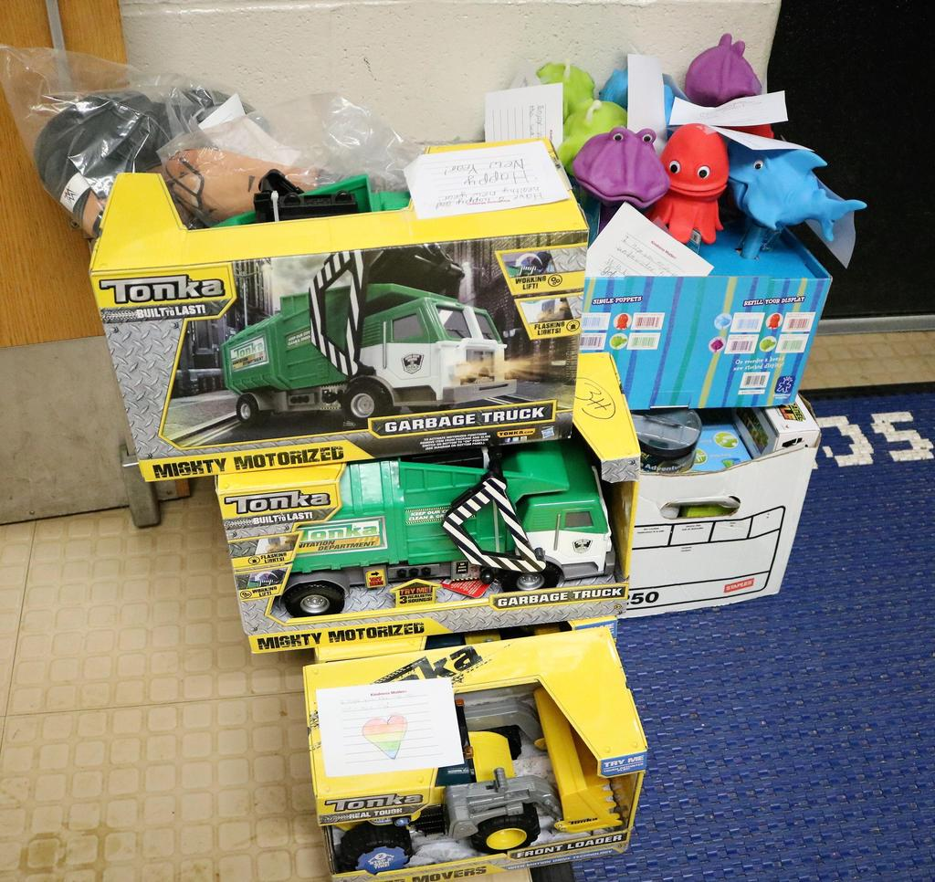 Photo of tonka trucks and other toys.