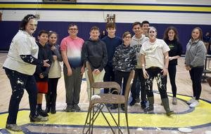 Teachers Amanda Stavish and Mary Jo Phillips pause for a picture with those Mars Area Middle School students selected to toss pies in their faces.