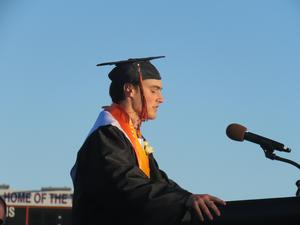 Senior Isaiah Guenther leads the class in the tassel ceremony.