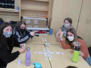 A small group of students enjoyed a lively card game.