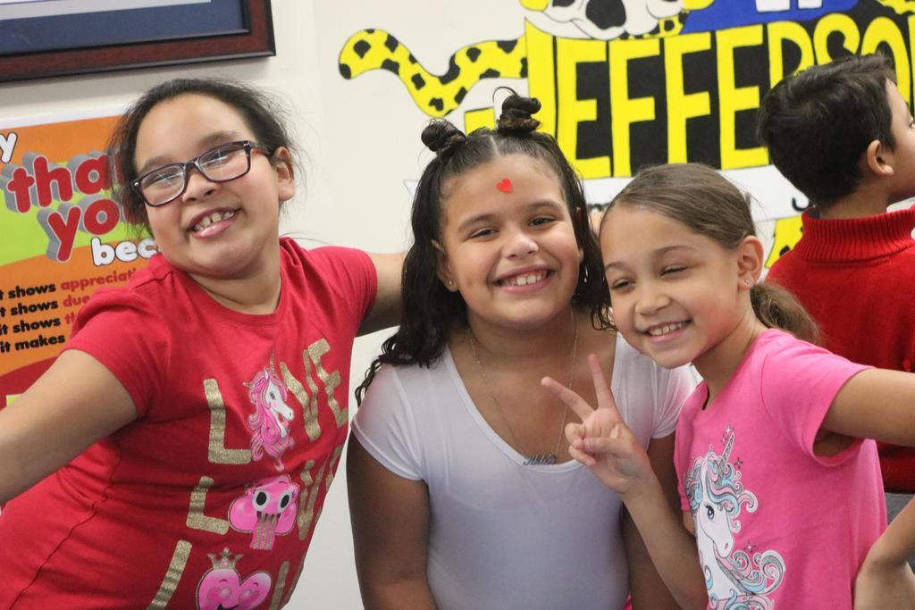 three girls happily posing