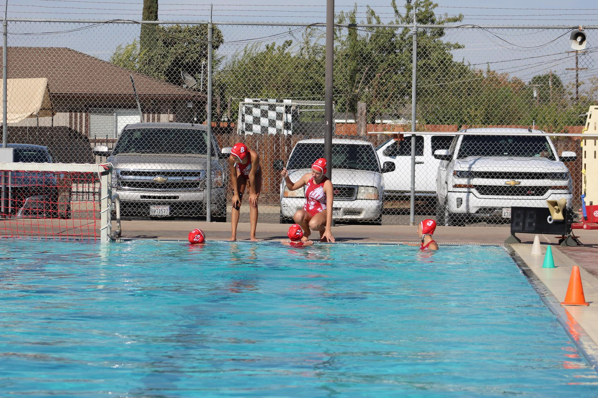 Girls playing water polo vs Fresno