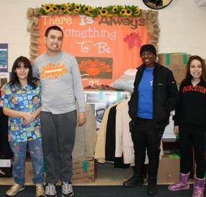 Students and representative from the INN in front of donations