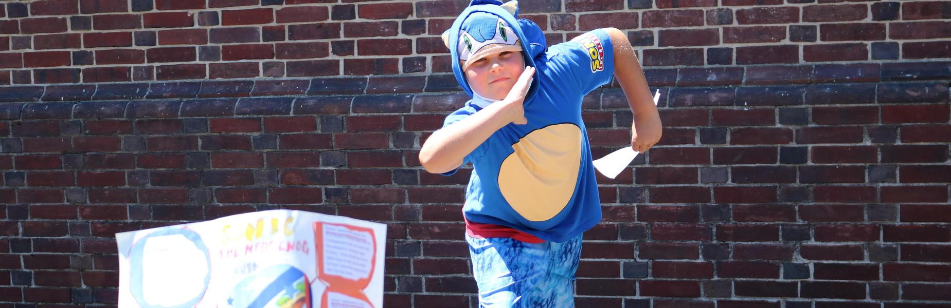 Franklin 3rd grader strikes a pose as Sonic the Hedgehog during Living Wax Museum.