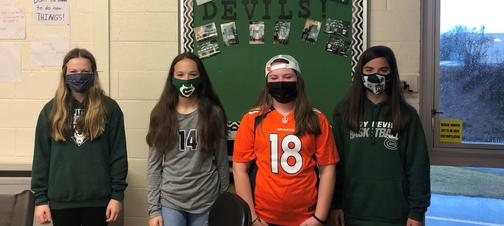 a picture of students dressed in athletic fan gear
