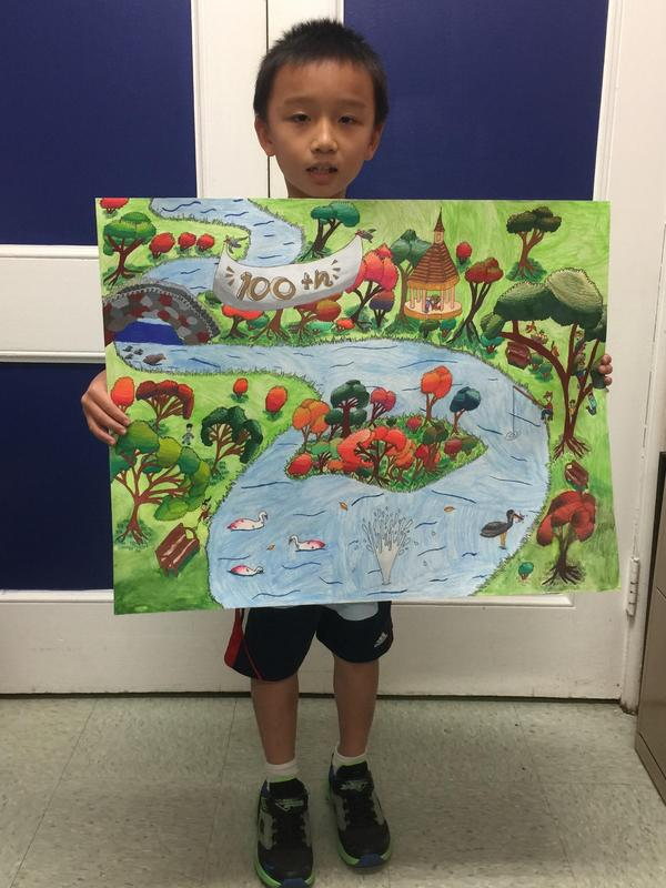 McKinley 4th grader Eric Yang displays 1st place poster he created for the AppleFest Art Contest in Westfield.