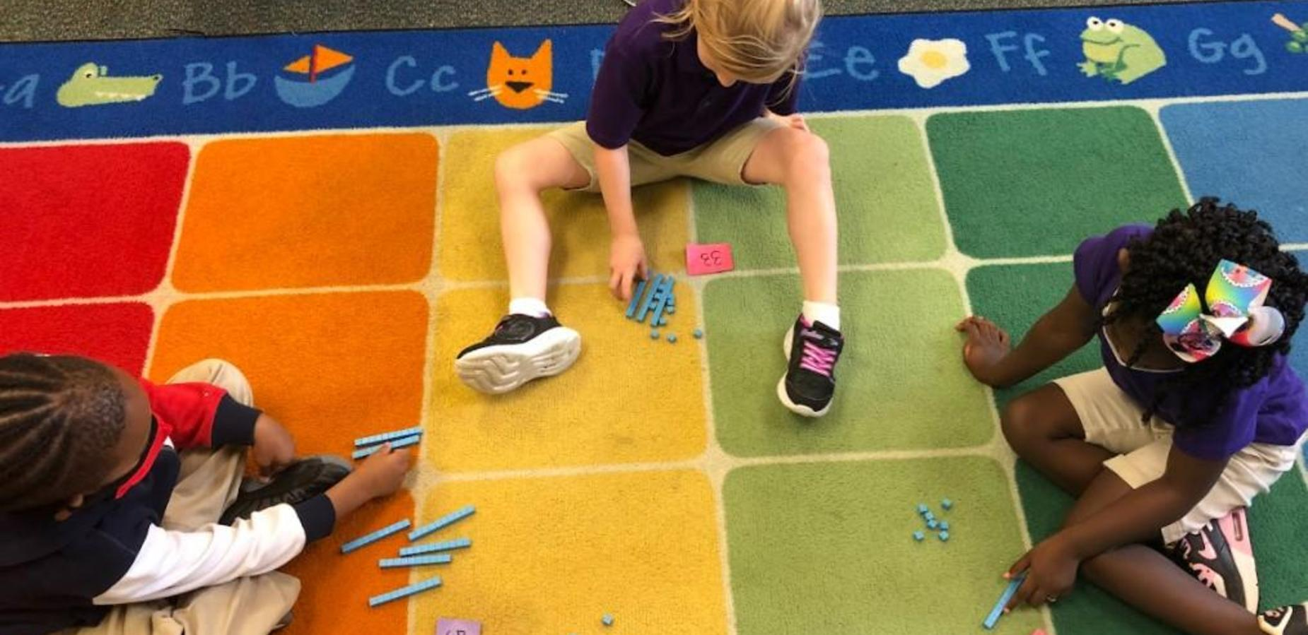 1st graders working with number blocks