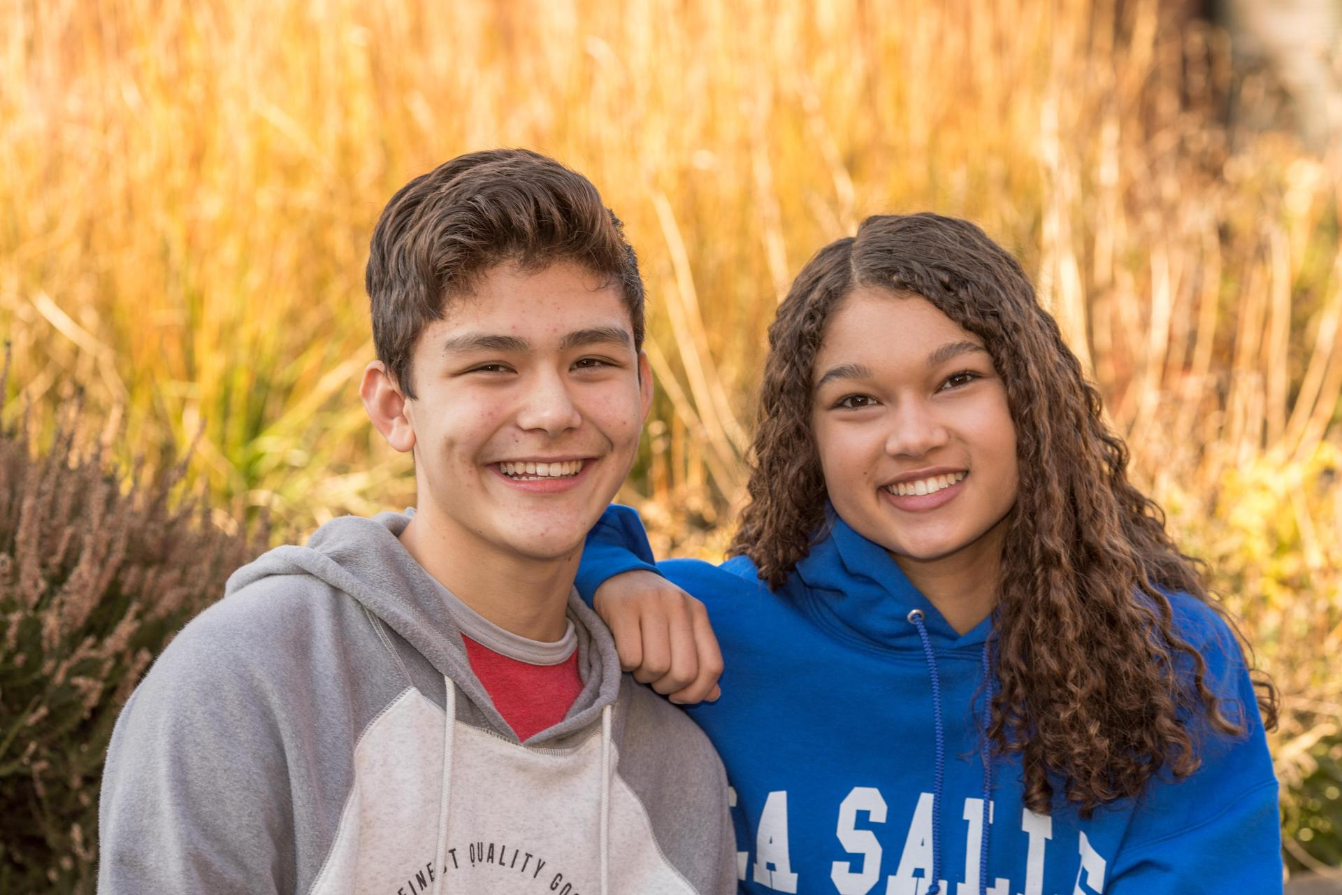male and female student smiling