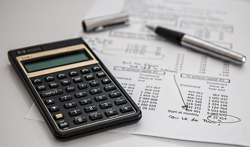 Image of a calculator and financial statement
