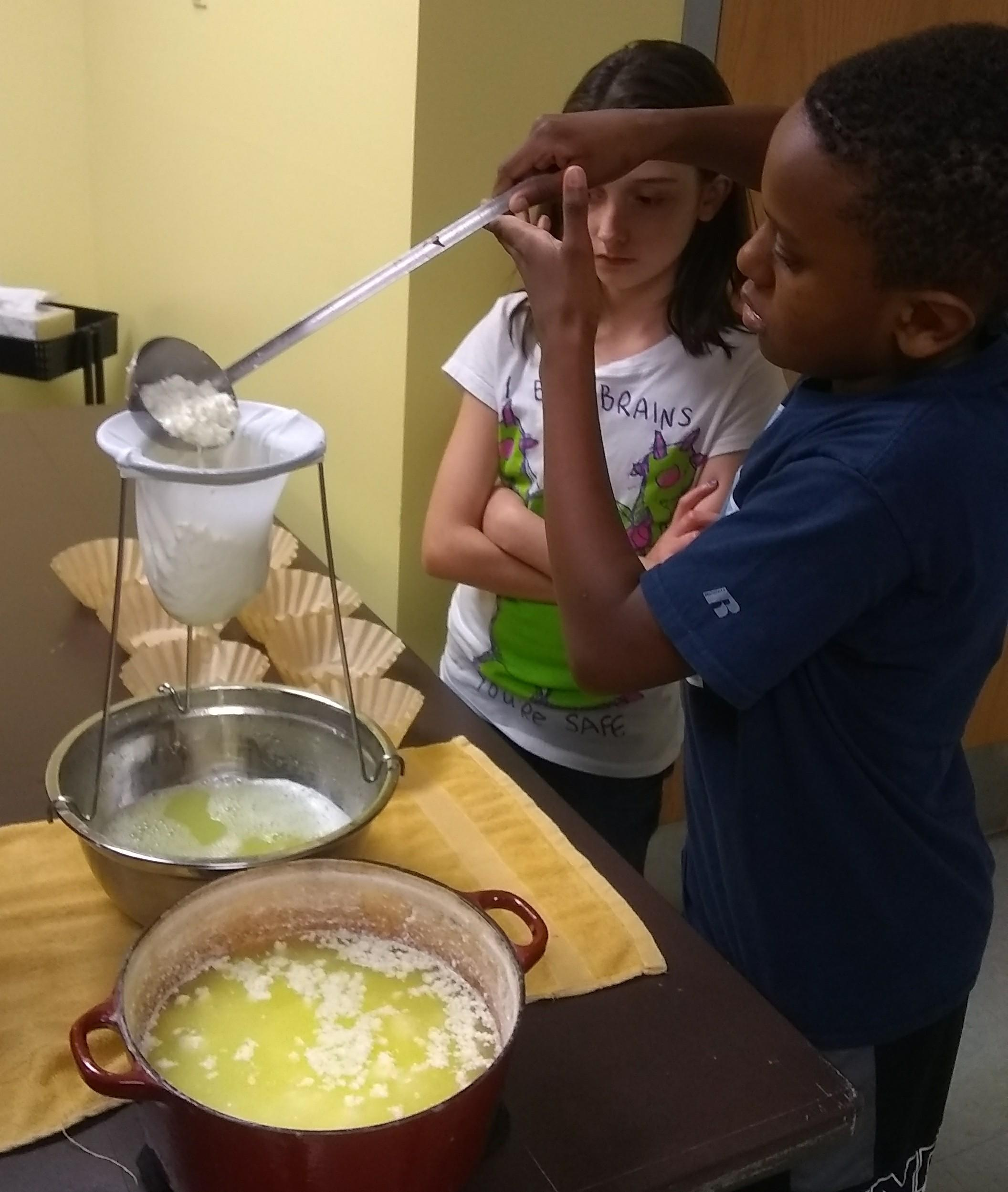 students straining cheese curds