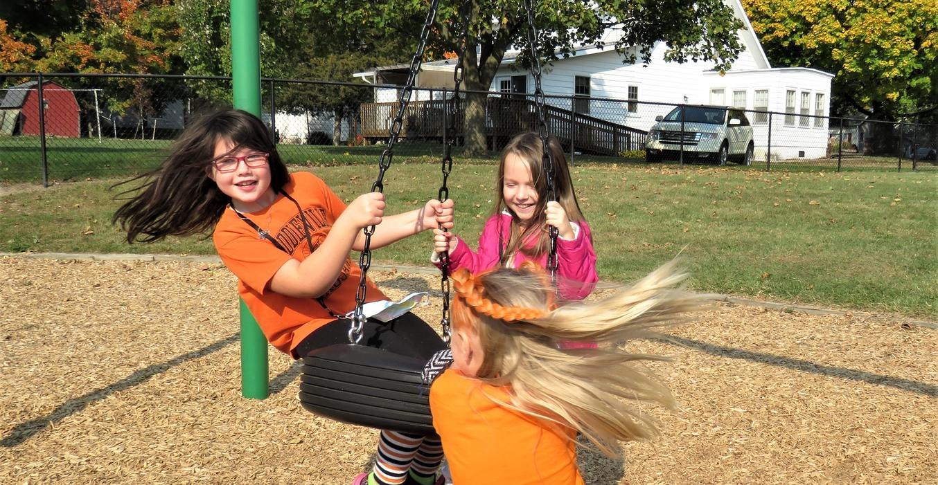 McFall students love to play on the tire swing.