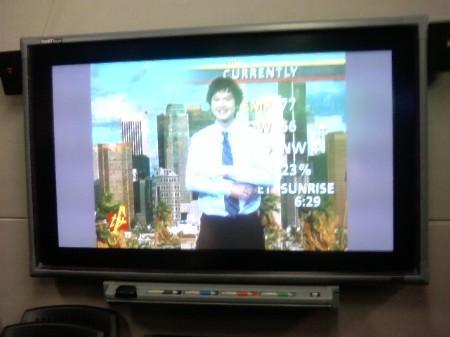 Student practicing at TV news studio