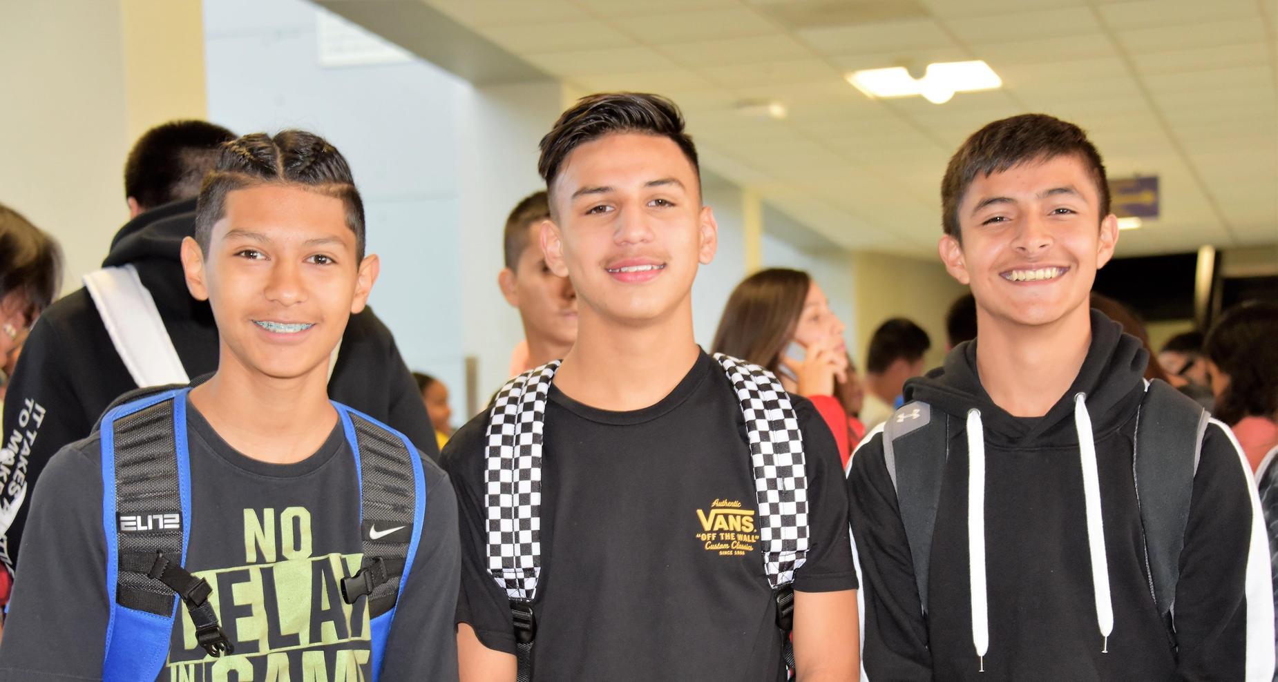 Boys smiling.