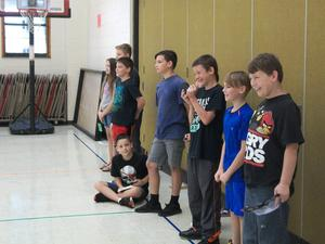Fifth graders wait their turn to try to walk wearing the Vision Impairment Goggles.