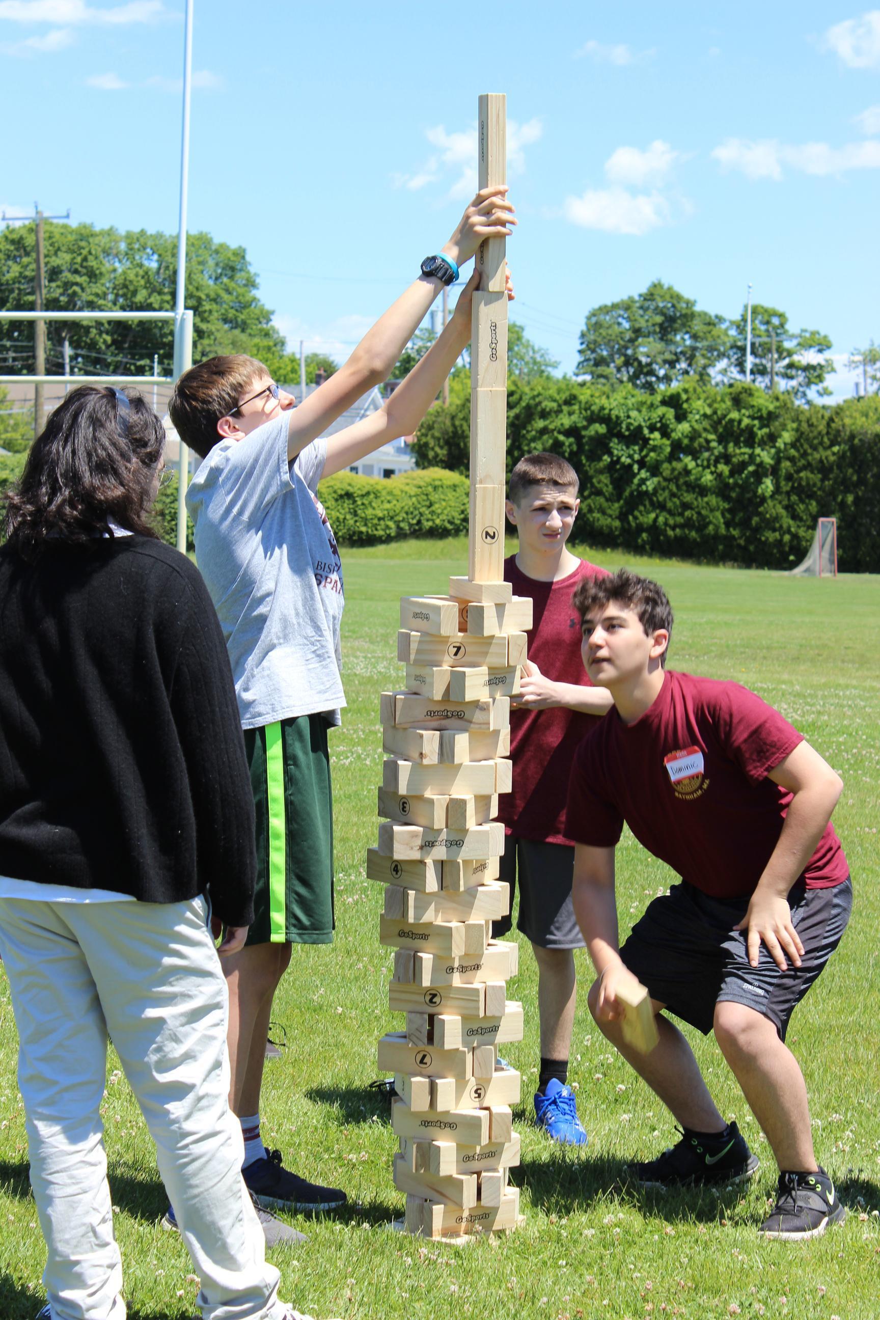 Students playing giant jenga game outside