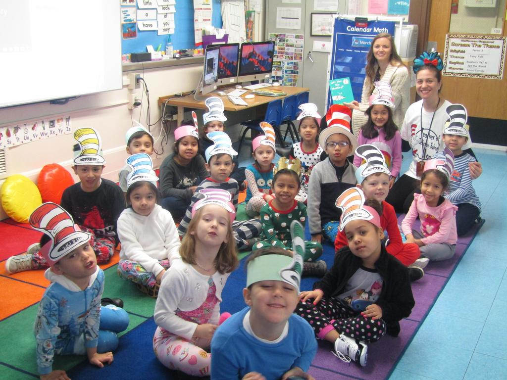 pre-k class wearing paper hats with teacher