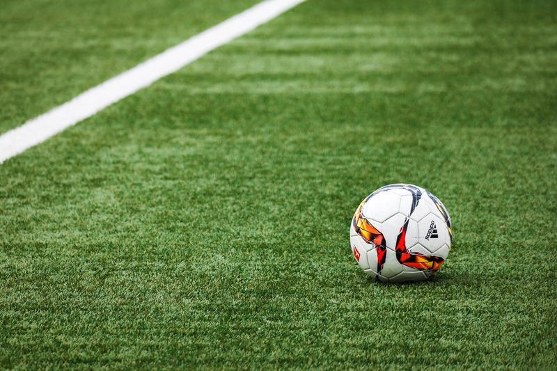A soccer ball on a turf field