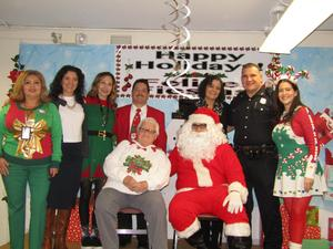 Mr. & Mrs. clause with Jefferson Admin and helpers