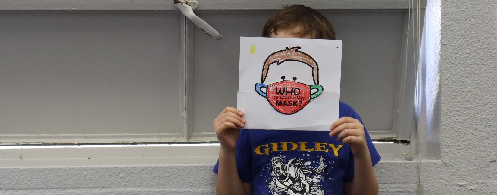 Student at Gidley poses with icebreaker game