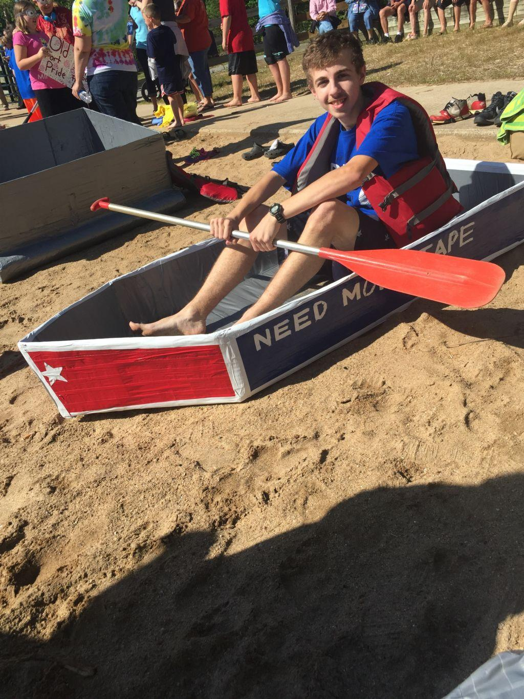 student preparing for the cardboard boat regatta
