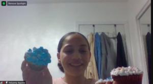 Yelianny Aquino showing her cupcakes on zoom
