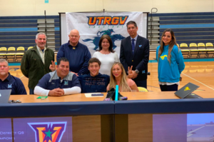 student with family celebrating signing letter of intent