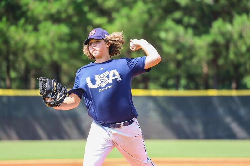 Tucker Holland pitches in the USA Baseball 13U NTIS this summer.