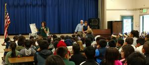 Principal Herbstreith shares the character traits Jason Dahl embodied as students look on
