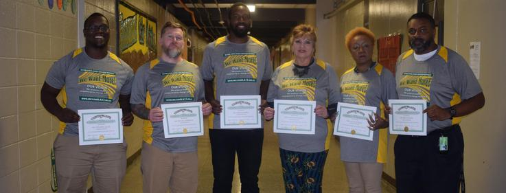 Denman Staff receives recognition for perfect attendance.