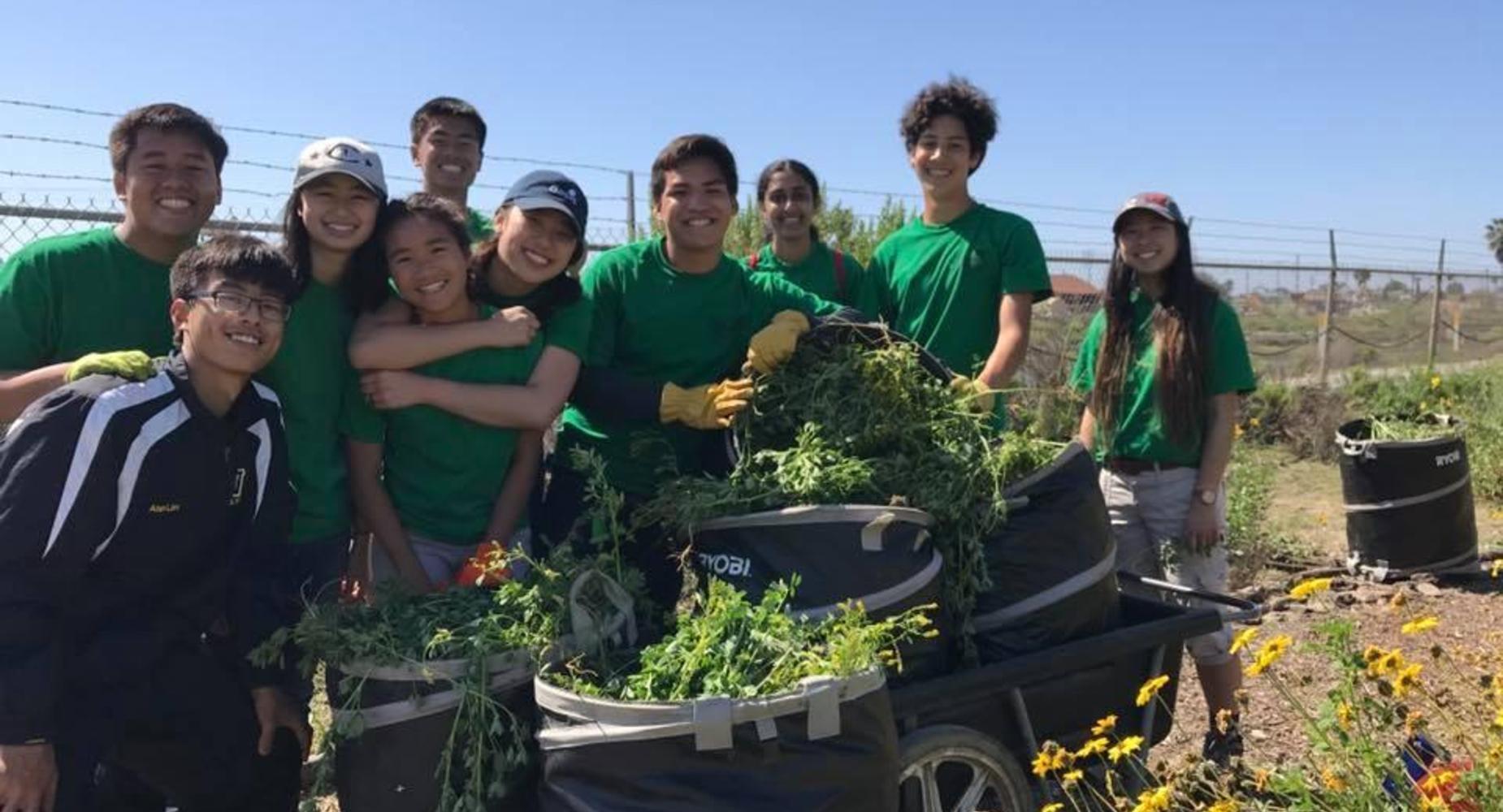 10 students gardening