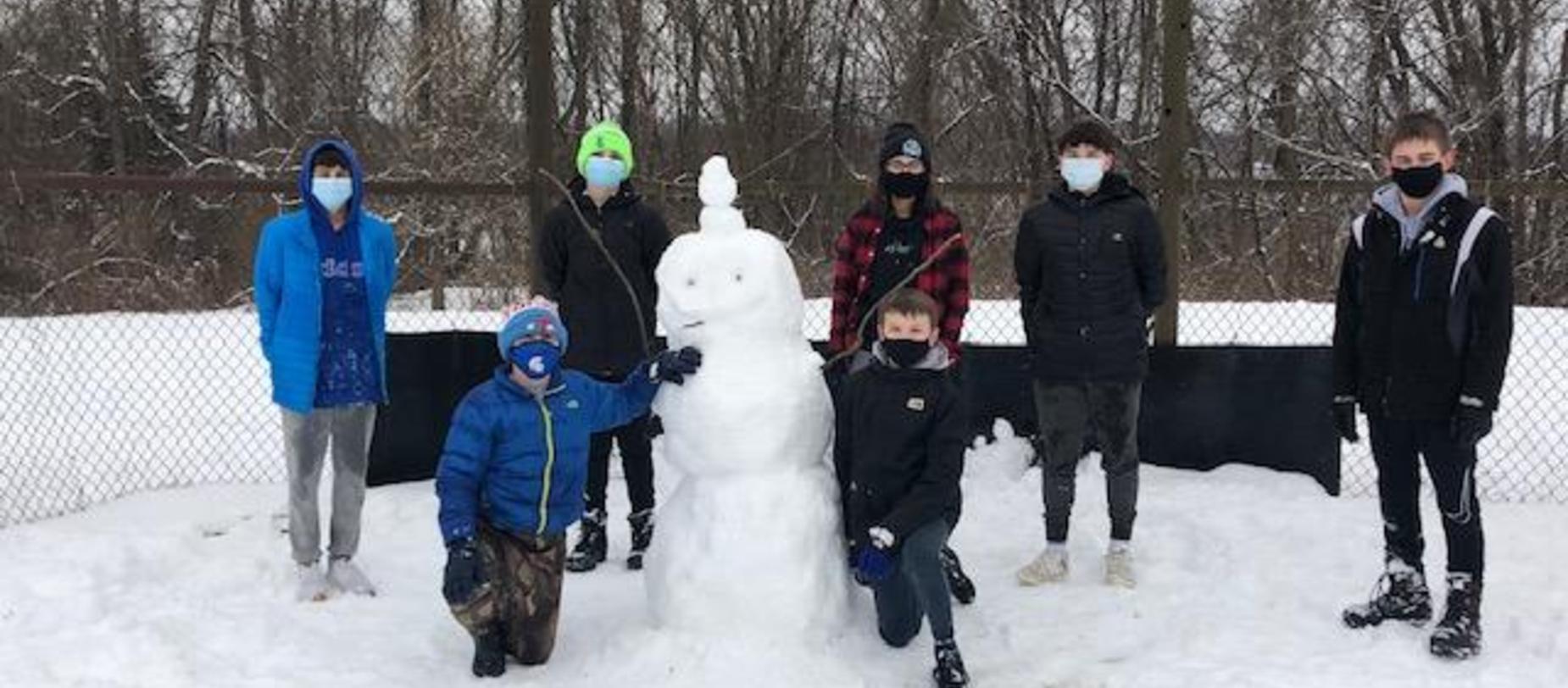 Teamwork to build a snowman