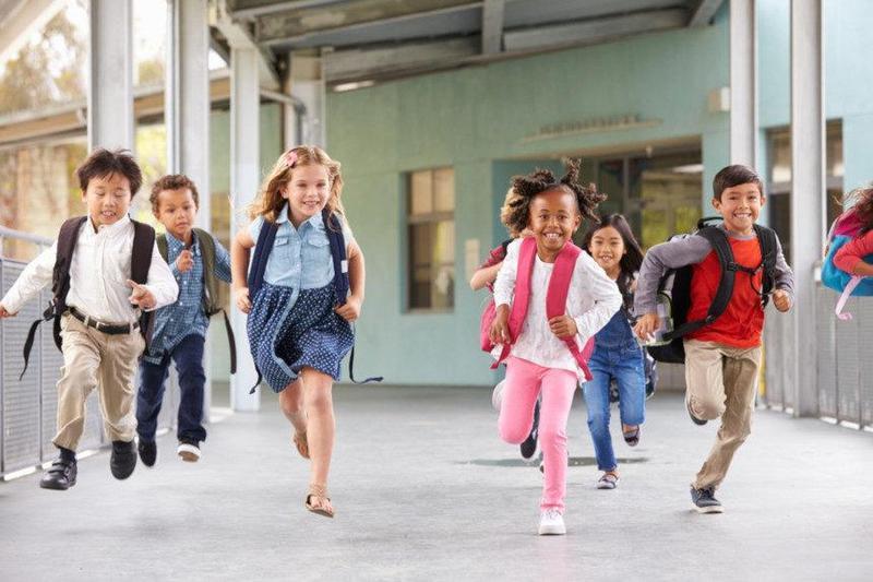 Children running back to school