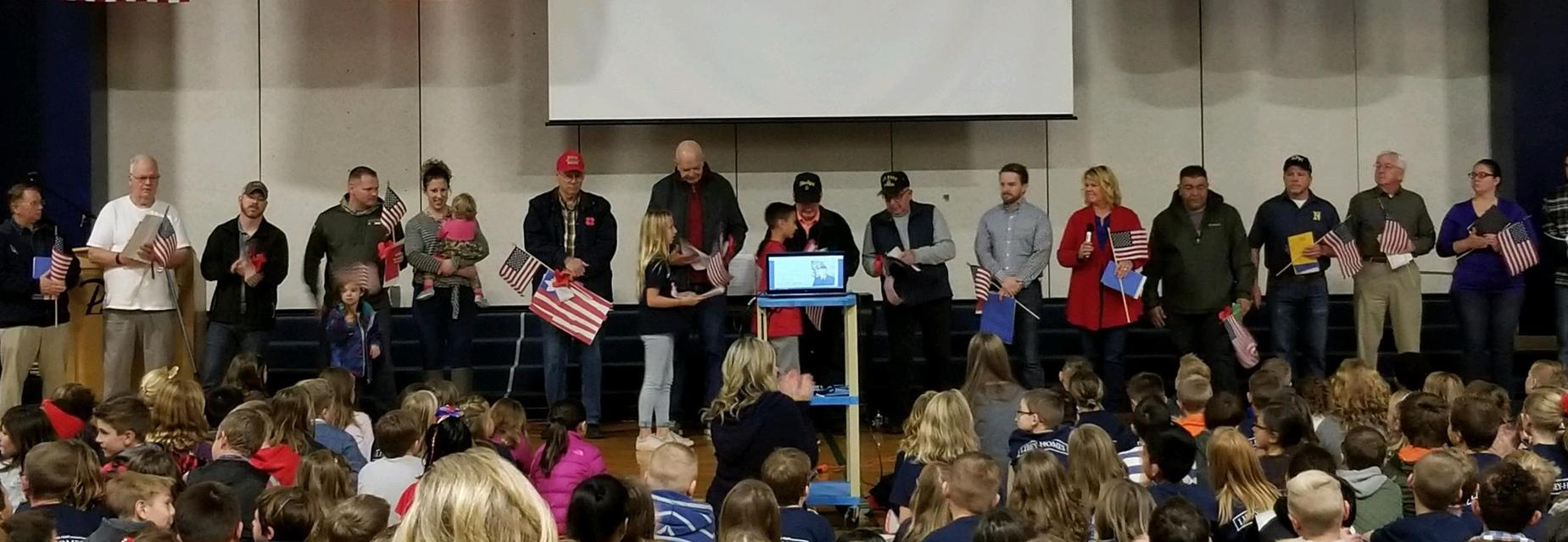 Honoring Veterans with flags, cards, and artwork at our annual assembly