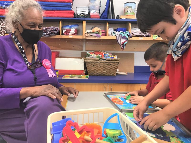 WLE Volunteer Grandma Davis with preschool students