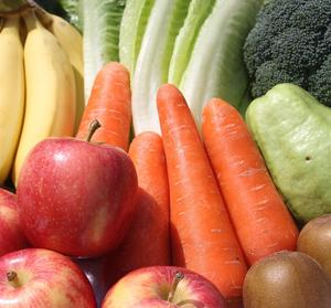 Close up of fruits and veggies - bananas, apples, carrots, lettuce