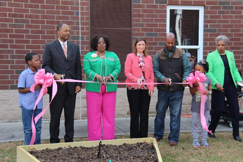 Community garden ribbon cutting ceremony.