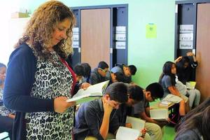 Ana Ponce and students read