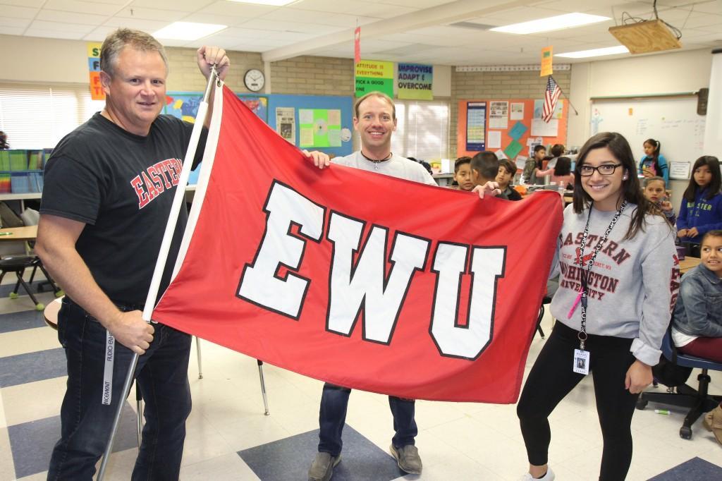 Staf holding EWU flag